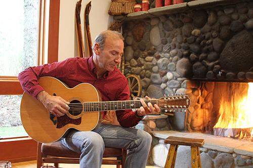 Paul Akers playing guitar